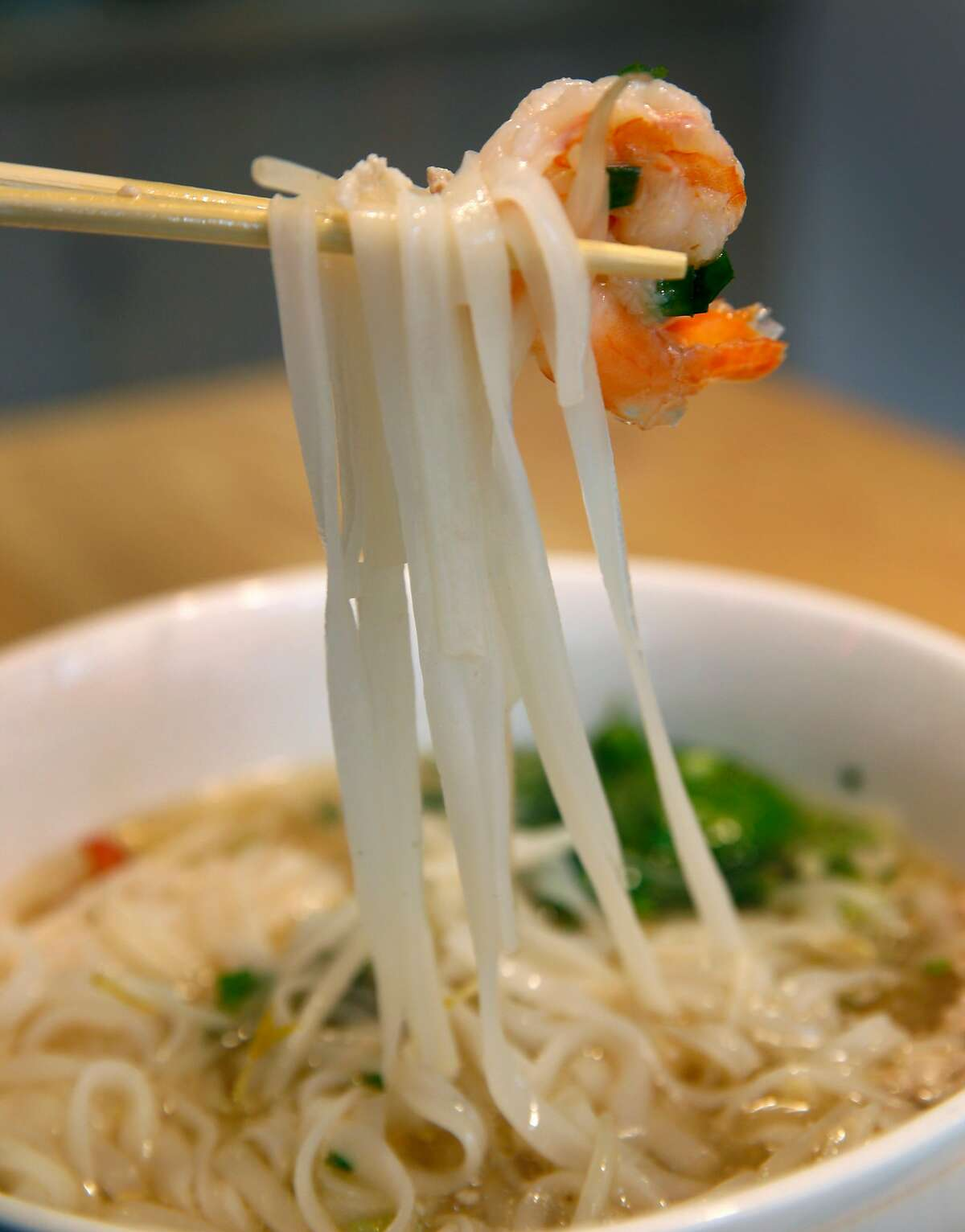 An order of the Kuy Teav Phnom Penh rice noodle soup, with minced pork and shrimp, is served at Nyum Bai Cambodian restaurant in Oakland, Calif. on Friday, Dec. 21, 2018.