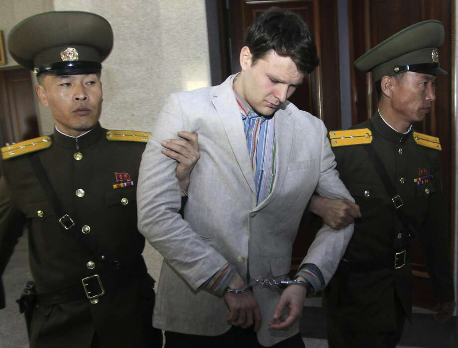 FILE - In this March 16, 2016, file photo, American student Otto Warmbier, center, is escorted at the Supreme Court in Pyongyang, North Korea. A federal judge has ordered North Korea to pay more than $500 million in a wrongful death suit filed by the parents of Otto Warmbier, an American college student who died shortly after being released from that country. (AP Photo/Jon Chol Jin, File) Photo: Jon Chol Jin, Associated Press