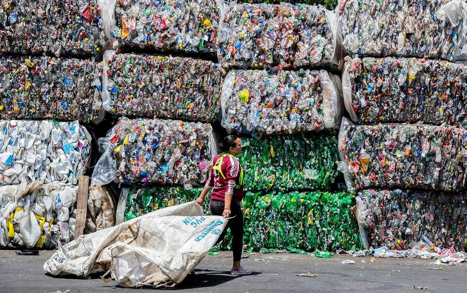 TOPSHOT - A worker walks in front of packed recyclable plastic bottles at La Sylvia recycling center in Barva, province of Heredia, Costa Rica on June 20, 2018. - Costa Rica discards 564 tons of plastic per day of which only 14 are recycled, according to the Ministry of Health's Office of Environmental Health in charge of waste management in the country. Since April 2018, a program seeks to stimulate recycling by giving value to waste through the exchange of it for a virtual currency that allows users to make purchases at stores linked with the initiative. (Photo by EZEQUIEL BECERRA / AFP)EZEQUIEL BECERRA/AFP/Getty Images Photo: Ezequiel Becerra, AFP/Getty Images