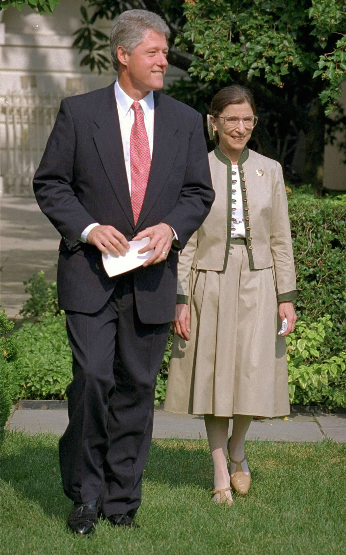 President Clinton and Judge Ruth Bader Ginsburg walk to the Rose Garden of the White House in this Aug. 3, 1993 file photo.