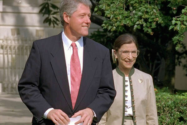 "FILE -- President Clinton and Judge Ruth Bader Ginsburg walk to the Rose Garden of the White House in this Aug. 3, 1993 file photo. ""If we gave up our freedom as the price of security, we would no longer be the great nation that we are,"" said Ginsburg. ""The job that we have is to show the world what are the values of our country, and why our country could never be put down by an episode like that. Our true strenth comes from being a land of freedom, a land of liberty, a land of democracy."""