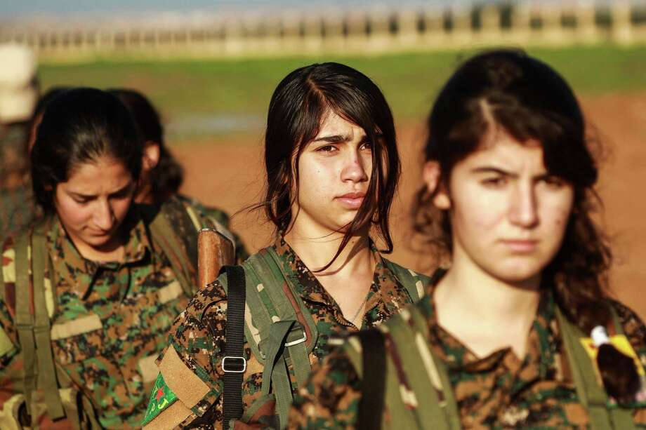 Fighters from the Kurdish women's protection units attend the funeral of an Arab fighter of the Syrian Democratic Forces in the town of Tal Tamr in the countryside of Syria's northeastern Hasakeh province on Friday, after he was killed while fighting against the Islamic State in Hajin in Deir Ezzor province. President Trump's decision to withdraw U.S. ground troops from Syria leaves groups fighting ISIS vulnerable to that group and to Turkey. Photo: DELIL SOULEIMAN /AFP /Getty Images / AFP or licensors