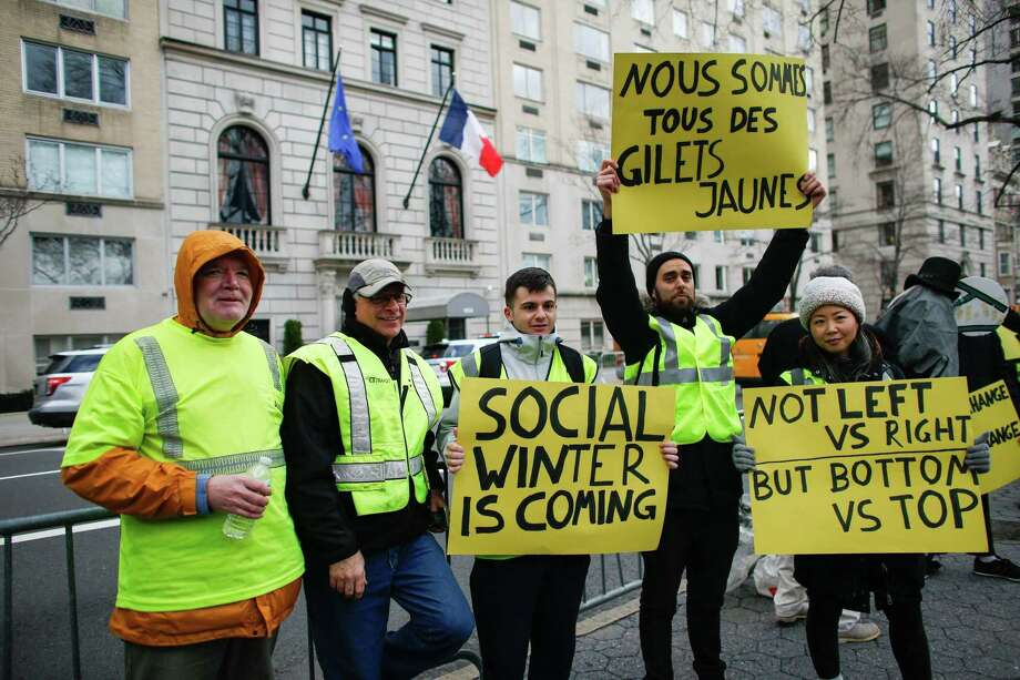 French President Emmanuel Macron has been humbled by the yellow vest protests — seen here in front of the French Consulate in New York — but a closer examination reveals that the march of populism is up against strong opposition in Europe and the United States. Photo: KENA BETANCUR /AFP /Getty Images / AFP or licensors