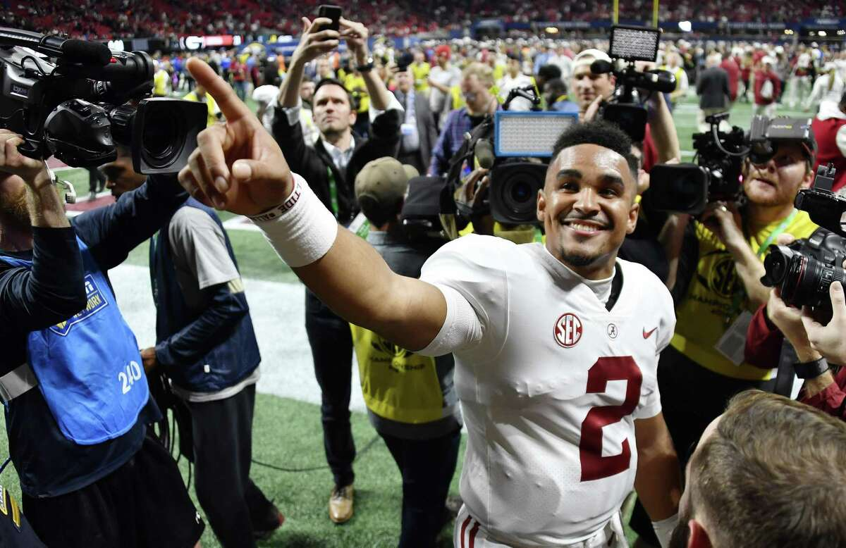 Through a series of ups and downs, Alabama quarterback Jalen Hurts (2) has kept a smile on his face and his focus on the field.