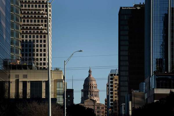 The Texas State Capitol building, center, stands in downtown Austin, Texas, U.S., on Thursday, Dec. 20, 2018. Apple Inc. announced this month it's opening new offices in Austin, investing $1 billion and bringing as many as 15,000 jobs to a city that was already the fastest growing in the nation for three years running -- with a thriving music and arts scene, an established technology industry, a rising national profile and a booming real estate market. Photographer: Callaghan O'Hare/Bloomberg