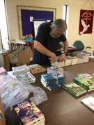 Michael Lawrence-Weden, pastor at Lord of Life Lutheran Church in San Antonio, opens the boxes of gifts and cards in this undated courtesy photo provided by Lawrence-Weden sent to him by the Lutheran Immigration and Refugee Service program. On Monday morning Dec 24, 2018, he and his wife, Rebecca Lawrence-Weden, loaded up the 1,600 cards and 286 children's books (in Spanish) and delivered them to Dilley's South Texas Family Residential Center.