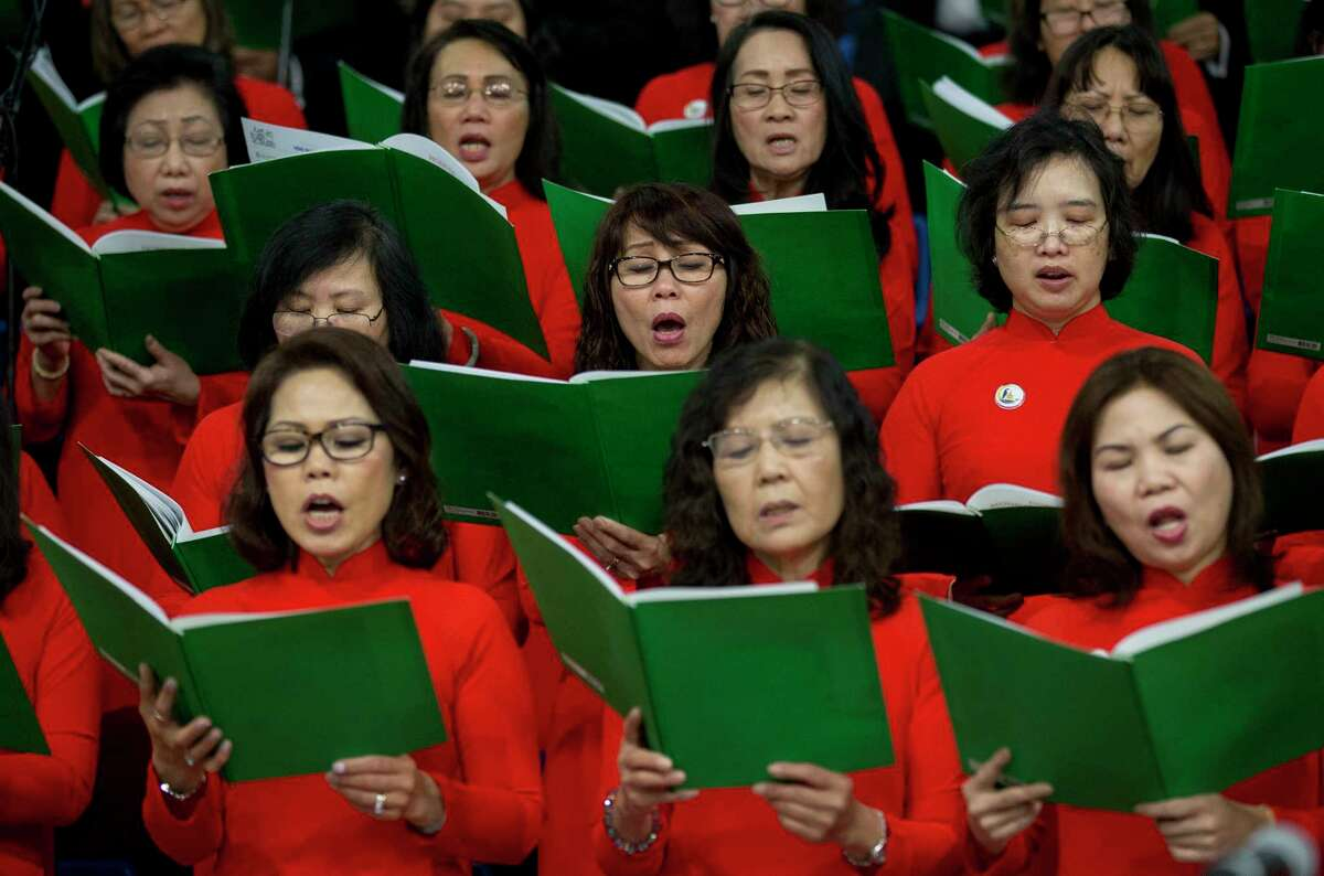 Our Lady of Lavang Church choir sings during the Vietnamese Catholic Association of the Archdiocese of Galveston-Houston annual Christmas Vigil Mass at the George R. Brown Convention Center Monday, Dec. 24, 2018.