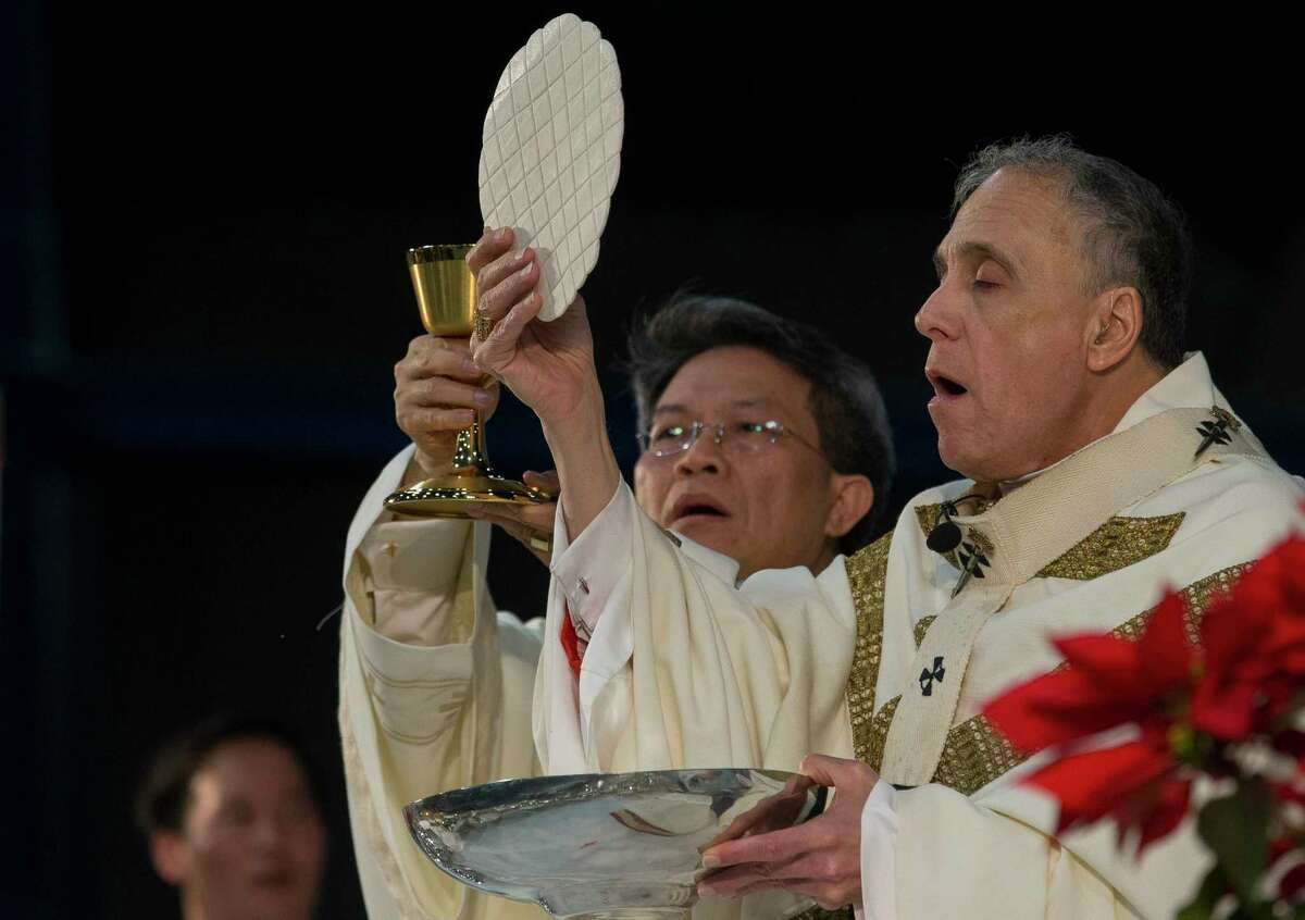 Archbishop Daniel DiNardo during the eucharist during the annual Christmas Vigil Mass at the George R. Brown Convention Center Monday, Dec. 24, 2018, in Houston.
