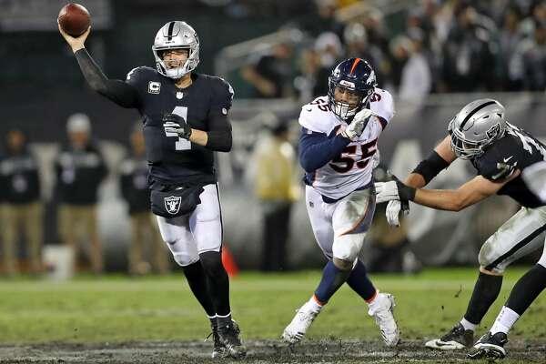 3of22Oakland Raiders  Derek Carr passes in 2nd quarter against Denver  Broncos  Bradley Chubb (55) during NFL game at Oakland Coliseum in Oakland 079b86b14