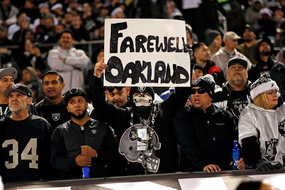 """An Oakland Raiders' fan holds a """"Farewell Oakland"""" sign during 1st half of Raiders' game against Denver Broncos at Oakland Coliseum in Oakland, Calif. on Monday, December 24, 2018. Photo: Scott Strazzante / The Chronicle 2018"""