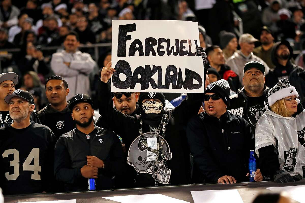 """An Oakland Raiders' fan holds a """"Farewell Oakland"""" sign during 1st half of Raiders' game against Denver Broncos at Oakland Coliseum in Oakland, Calif. on Monday, December 24, 2018."""