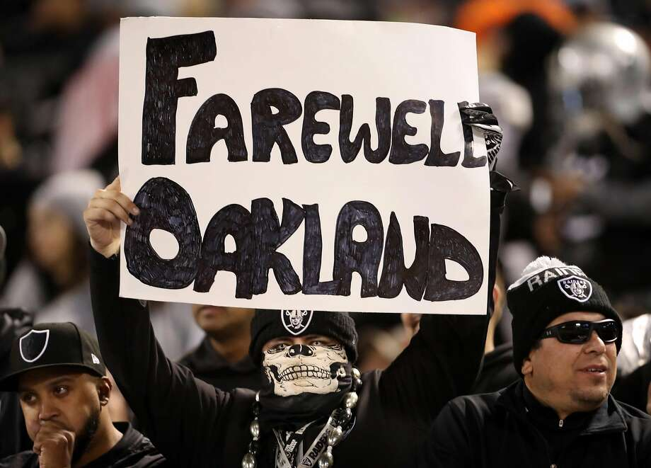 "An Oakland Raiders' fan holds a ""Farewell Oakland"" sign during 1st half of Raiders' game against Denver Broncos at Oakland Coliseum in Oakland, Calif. on Monday, December 24, 2018. Photo: Scott Strazzante / The Chronicle 2018"