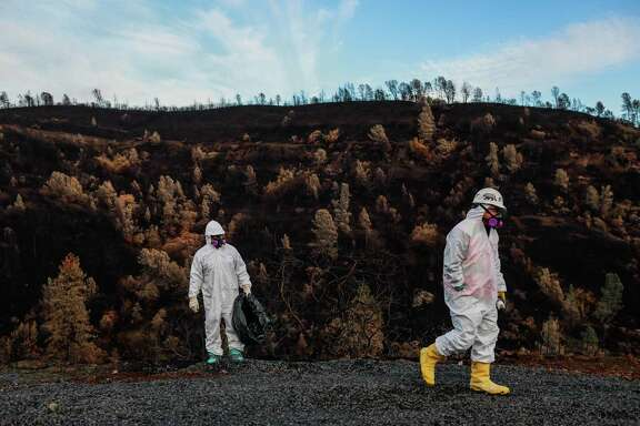 Contractors with the Environmental Protection Agency search for hazardous materials at a property that was destroyed by the Camp Fire in Paradise on Wednesday, December 5, 2018.