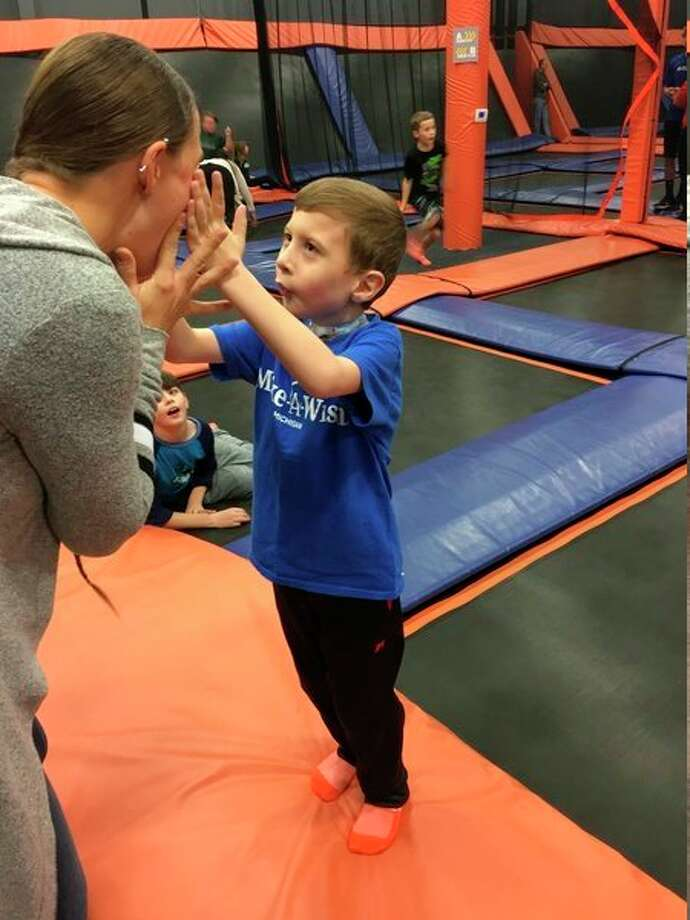 Levi Wheeler jumps around during a welcome home party at the SkyZone Trampoline Park in Saginaw on Nov. 17 after Levi's Make-A-Wish trip to Disney World. (Photo provided)