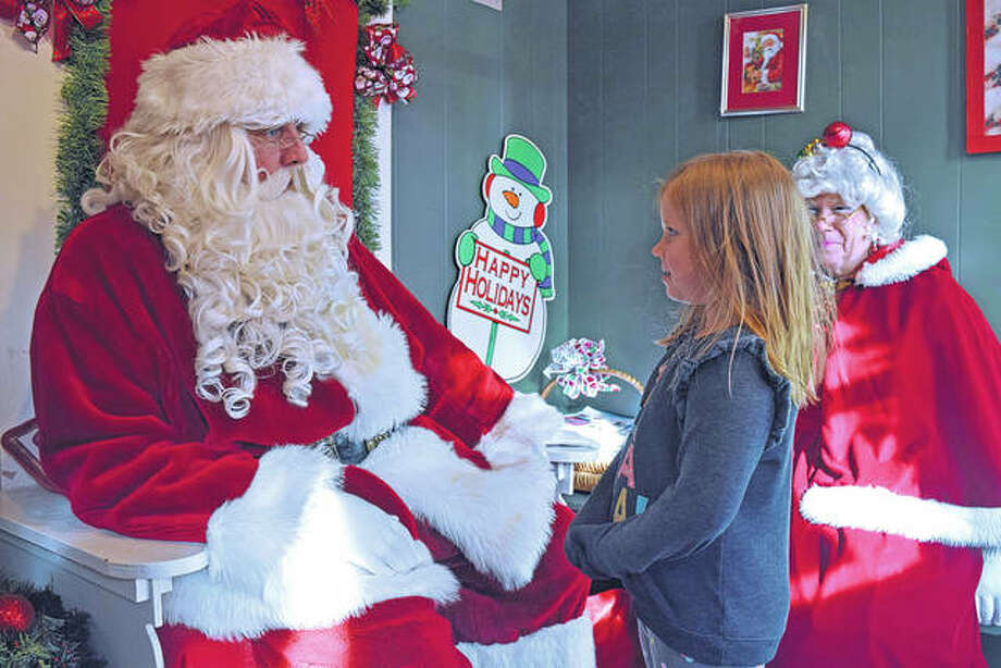 Josie Grimsley, 6, of Jacksonville shares her last-minute Christmas wishes with Santa Claus on Monday during his last trip to Jacksonville before heading out to deliver gifts around the world.