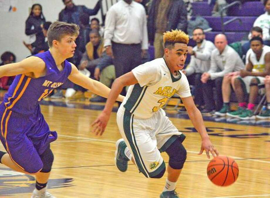 Metro-East Lutheran junior Jason Williams, right, drives past a Mount Olive player in a semifinal game at the Class 1A Mount Olive Regional last season. Photo: Scott Marion/Intelligencer
