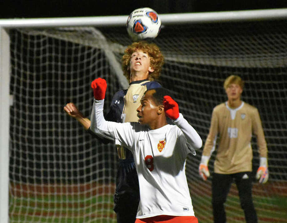FMCHS center back DJ Villhard goes high to head a ball away from an opponent. Photo: Matt Kamp/Intelligencer