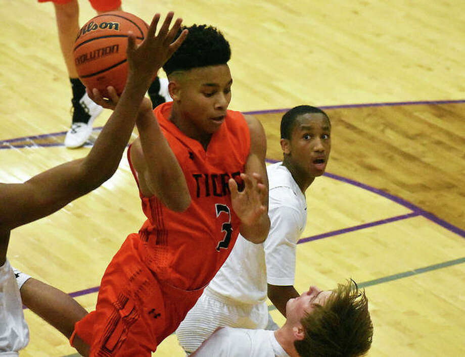 Edwardsville point guard Malik Robinson draws contact on his way to the basket. Photo: Matt Kamp/Intelligencer