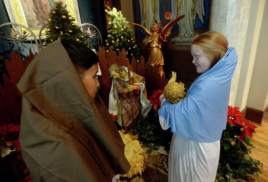 Ivan Hernandez and Lila Maloney portrayed Joseph and Mary and joined in a children's procession to place a statue of Jesus in the Nativity scene during the children and family mass held at St. Anthony Catholic Basilica in Beaumont on Christmas Eve.  Photo taken Monday, December 24, 2018 Photo by Kim Brent/The Enterprise Photo: Kim Brent/The Enterprise