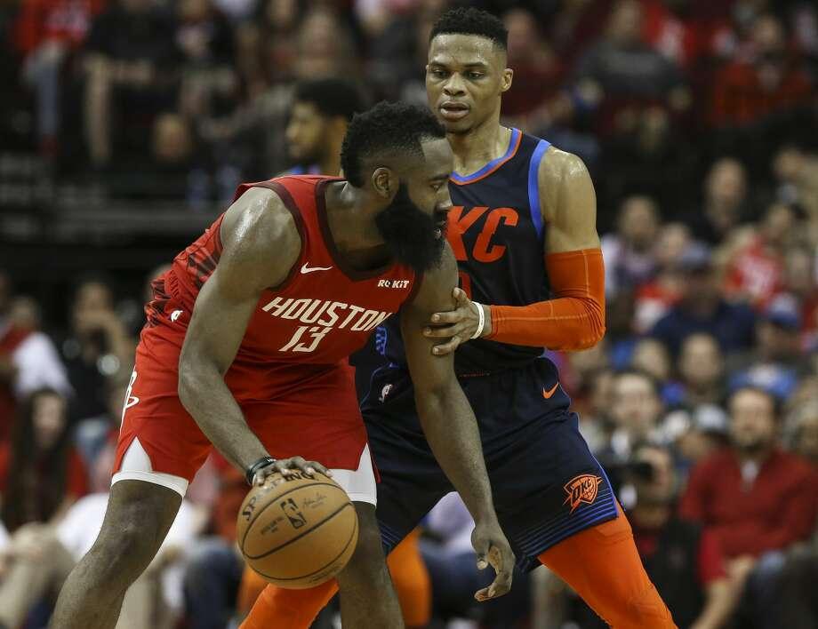 e07f6917e501 Oklahoma City Thunder guard Russell Westbrook (0) is defensing Houston  Rockets guard James Harden