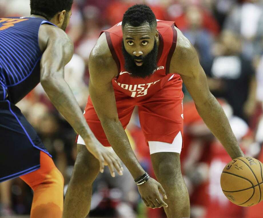 Houston Rockets guard James Harden, right, dribbles as Oklahoma City Thunder forward Paul George defends during the second half of an NBA basketball game, Tuesday, Dec. 25, 2018, in Houston. Houston won 113-109. (AP Photo/Eric Christian Smith) Photo: Eric Christian Smith, FRE / Associated Press / Copyright 2018 The Associated Press. All rights reserved.
