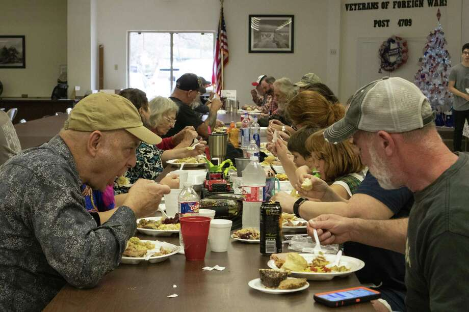 Veterans and community members eat a Christmas lunch together during the annual Conroe Veterans of Foreign War Post 4709 Christmas Day lunch, Tuesday, Dec. 25, 2018, in Conroe. Photo: Cody Bahn, Houston Chronicle / Staff Photographer / © 2018 Houston Chronicle