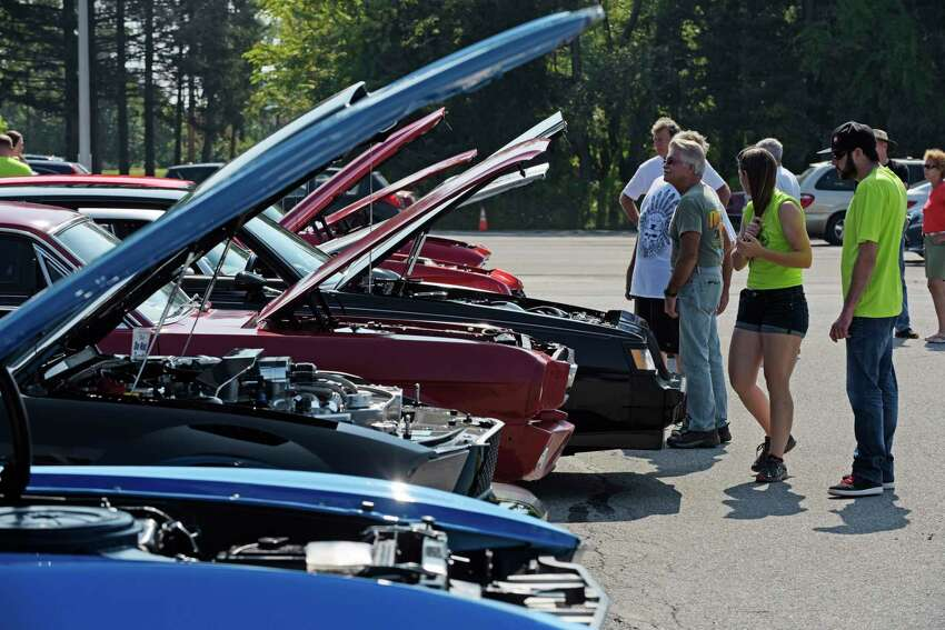 People make their around to look over the various cars on display at the 7th Annual Times Union Hope Fund Car Show on Sunday, Sept. 17, 2017, in Colonie, N.Y. (Paul Buckowski / Times Union)