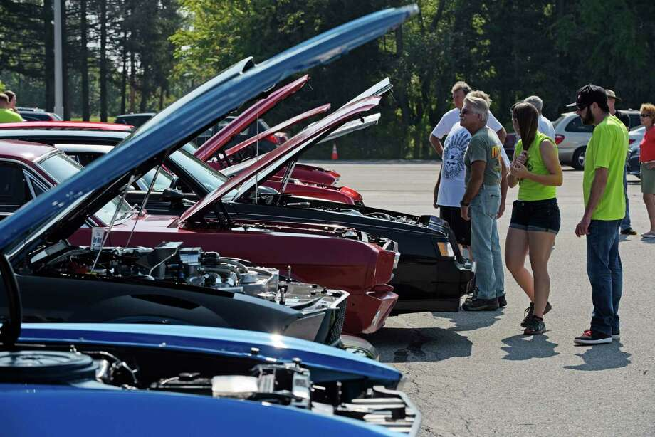 People make their around to look over the various cars on display at the 7th Annual Times Union Hope Fund Car Show on Sunday, Sept. 17, 2017, in Colonie, N.Y.   (Paul Buckowski / Times Union) Photo: PAUL BUCKOWSKI / 40041550A