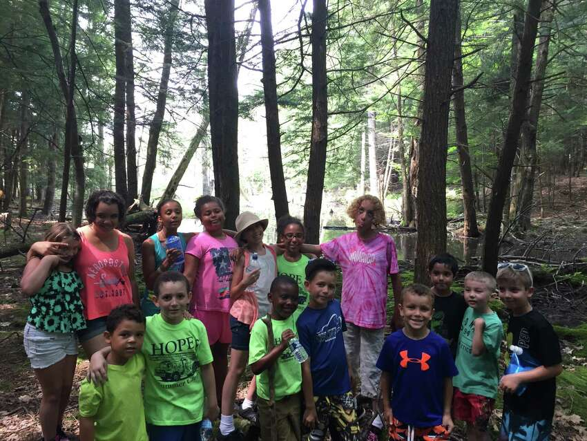 Children pose for a picture after a nature walk at the traveling summer day camp run by Hope 7 Community Center in Troy. An additional 30 children from low-income families will be able attend this summer through a $5,000 grant from the Times Union Hope Fund (Photo courtesy Hope 7 Community Center)