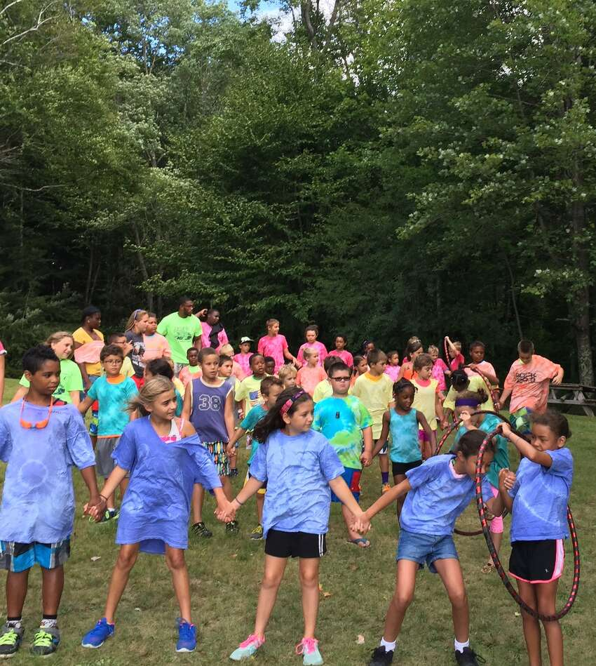 Children work on a team-building exercise at the traveling summer day camp run by Hope 7 Community Center in Troy, which 30 additional children will attend this summer through a $5,000 grant from the Times Union Hope Fund (Photo courtesy Hope 7 Community Center)
