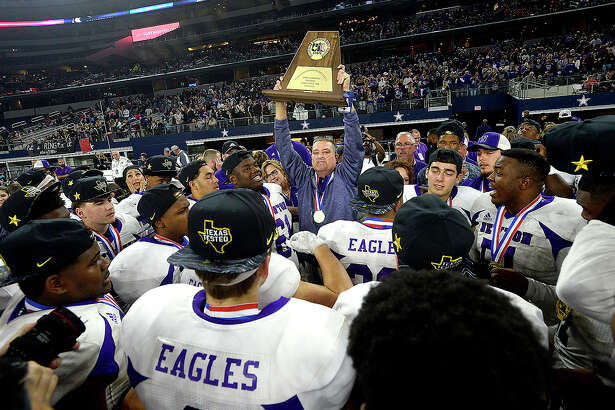 Newton gathers round head coach W. T. Johnston as he congratulates therm on their repeat state title victory after defeating Candian 21 - 16 during their state final Class 3A Div. II game at AT&T Stadium. Photo taken Thursday, December 20, 2018 Kim Brent/The Enterprise