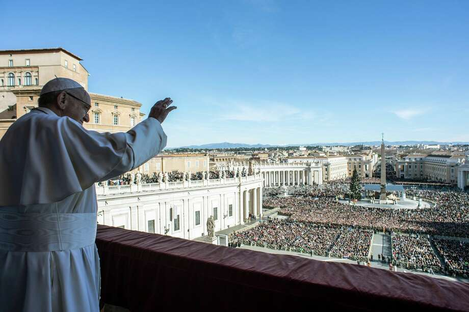 "This handout picture released by the Vatican press office on December 25, 2018 at St Peter's square in Vatican shows Pope Francis waving from the balcony of St Peter's basilica during the traditional ""Urbi et Orbi"" Christmas message to the city and the world. (Photo by ho / VATICAN MEDIA / AFP) / RESTRICTED TO EDITORIAL USE - MANDATORY CREDIT ""AFP PHOTO / VATICAN PRESS OFFICE"" - NO MARKETING NO ADVERTISING CAMPAIGNS - DISTRIBUTED AS A SERVICE TO CLIENTS ---HO/AFP/Getty Images Photo: HO / AFP"