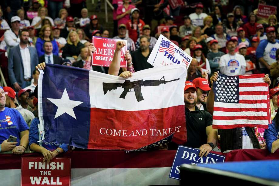 FILE-- Supporters hold flags as President Donald Trump makes remarks during a campaign rally for Sen. Ted Cruz (R-Texas) and other Texas Republicans in Houston, Oct. 22, 2018. More people died from firearm injuries in the U.S. in 2017 than in any other year since at least 1968, according to data from the Centers for Disease Control and Prevention. (Doug Mills/The New York Times) Photo: DOUG MILLS / NYTNS