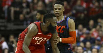 9aede2c6b1c Oklahoma City Thunder guard Russell Westbrook (0) is defensing Houston  Rockets guard James Harden (13) during the fourth quarter of the NBA game  at Toyota ...