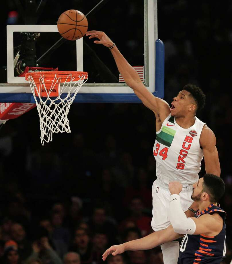 Milwaukee Bucks' Giannis Antetokounmpo, top, tries to dunk over New York Knicks' Enes Kanter during the first half of the NBA basketball game, Tuesday, Dec. 25, 2018, in New York. (AP Photo/Seth Wenig) Photo: Seth Wenig / Copyright 2018 The Associated Press. All rights reserved.