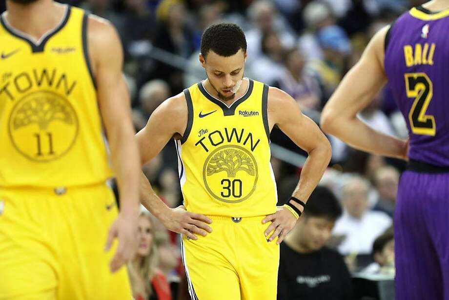 99c9f438b014 Golden State Warriors  Stephen Curry looks down after falling down by 15  points to Los