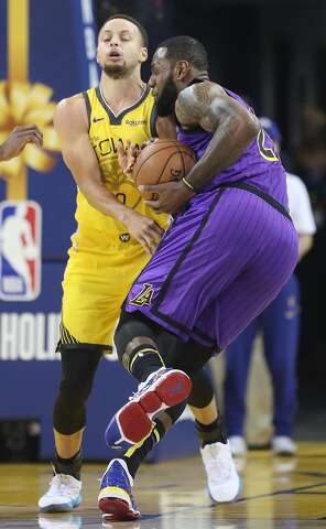 4d1a0f5cec2f Golden State Warriors  Stephen Curry tries to slow down Los Angeles Lakers   LeBron James