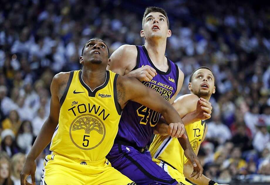 Golden State Warriors' Kevon Looney and Stephen Curry and Los Angeles Lakers' Ivica Zubac vie for rebound position in 4th quarter of Lakers' 127-101 win during NBA game at Oracle Arena in Oakland, Calif. on Tuesday, December 25, 2018. Photo: Scott Strazzante / The Chronicle