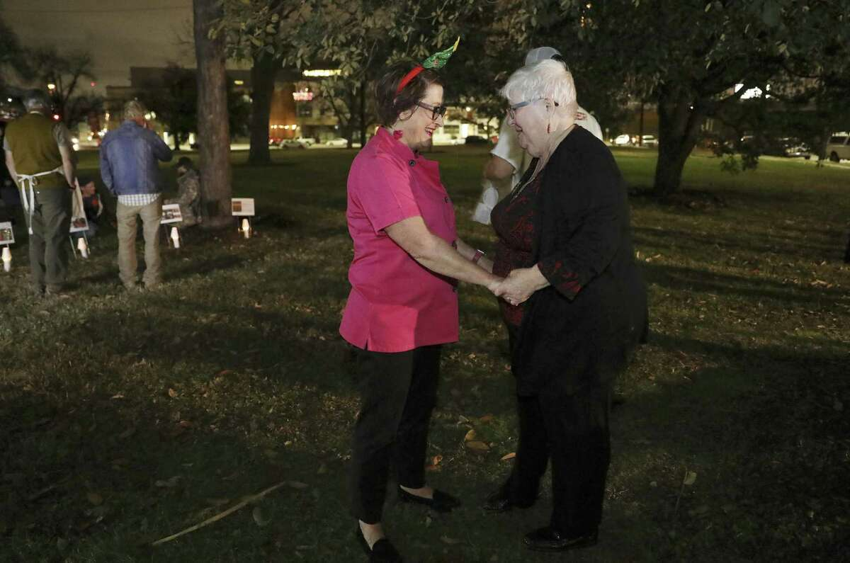 Sister Gabriella Lohan, right, greets Joan Cheever, at a gathering in Maverick Park, Tuesday, Dec. 25, 2018. After 13 years of providing hot dinners for the homeless, Cheever ended her volunteer service at her last stop of the night. A trained chef, author and documentary filmmaker, Cheever is a vocal advocate for the homeless as a writer and lawyer. She said The Chow Train itself, which also travels to disaster scenes to help the