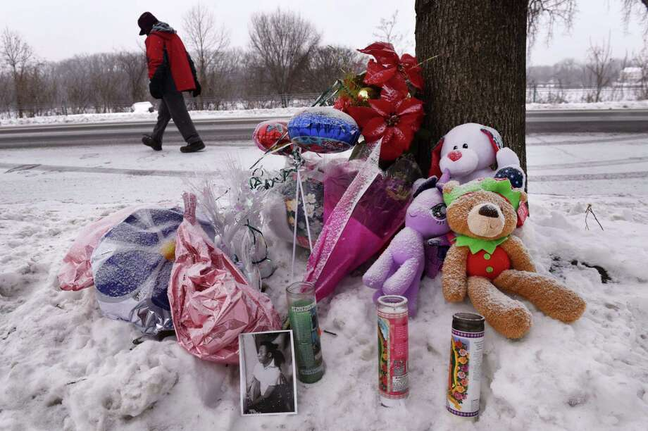 A make-shift memorial for the four killed at 158 Second Ave. continues to build on Saturday, Dec. 30, 2017, in Troy, N.Y.  Two Schenectady men were arraigned on several murder charges Saturday morning following the brutal slayings of two women and two children. (Will Waldron/Times Union) Photo: Will Waldron / 20042534A