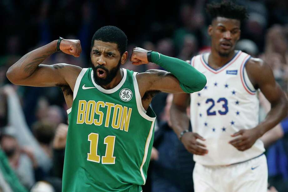 Boston Celtics' Kyrie Irving (11) reacts in front of Philadelphia 76ers' Jimmy Butler after making a 3-pointer in overtime during an NBA basketball game in Boston, Tuesday, Dec. 25, 2018. Boston won 121-114. (AP Photo/Michael Dwyer) Photo: Michael Dwyer / Copyright 2018 The Associated Press. All rights reserved