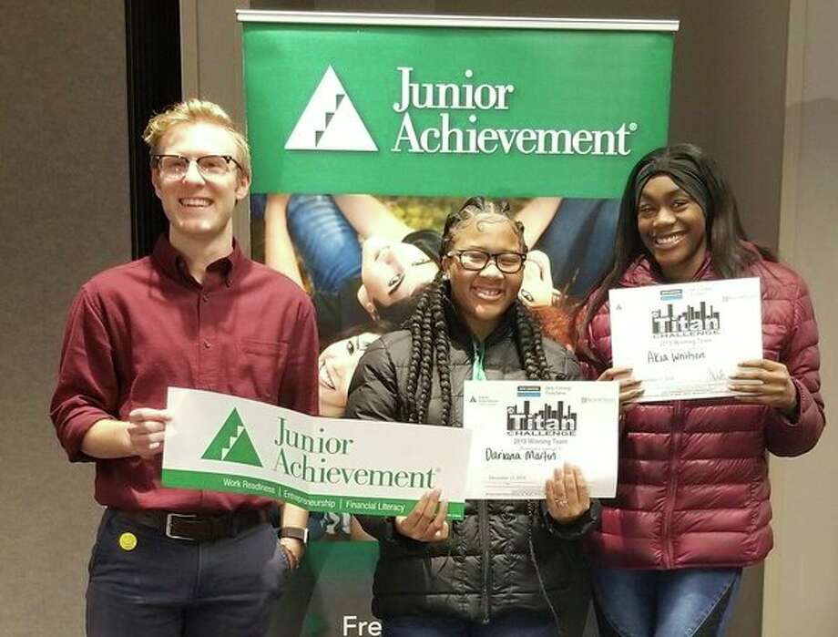 The Junior Achievement Titan Business Challenge winning team includes coach Andy Holtz with Dariana Martin and Akia Whitson. (Photo provided)