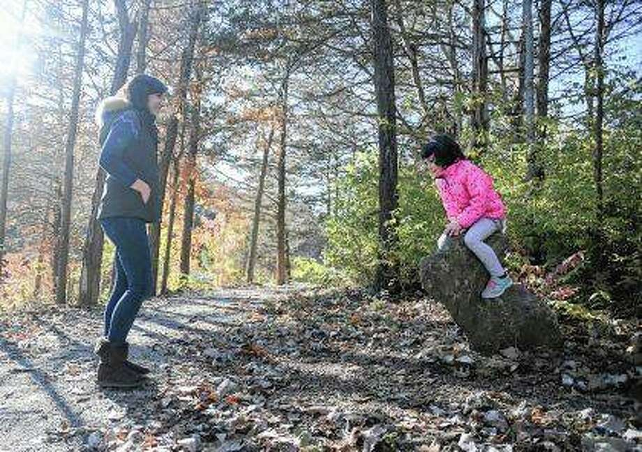 "Christina Fuhrman, an advocate for careful antibiotic use, watches her 4-year-old daughter, Pearl, as she plays with her ""bunny rock"" during a walk on a trail near their home. Photo: Phu Nguyen 