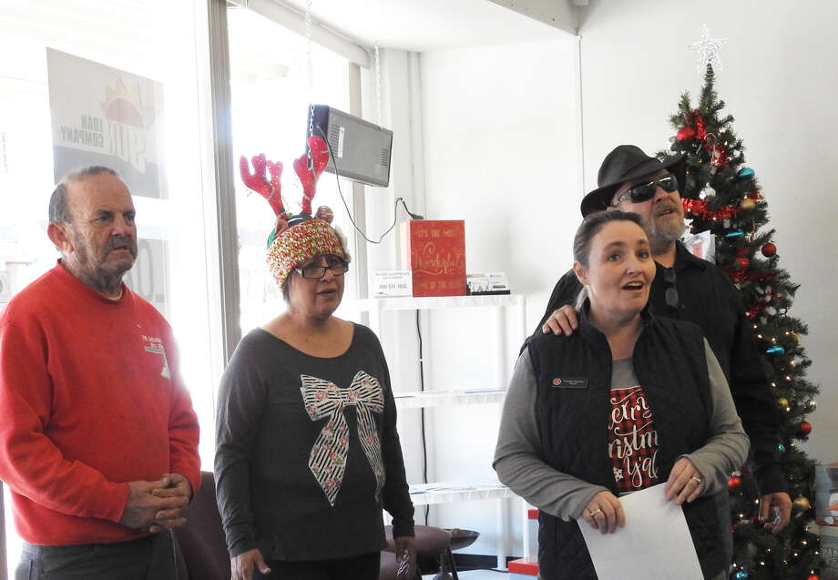 A group of carolers with the Salvation Army visited businesses around downtown Plainview singing Christmas carols. Photo: Courtesy Photos/Phyllis Wall
