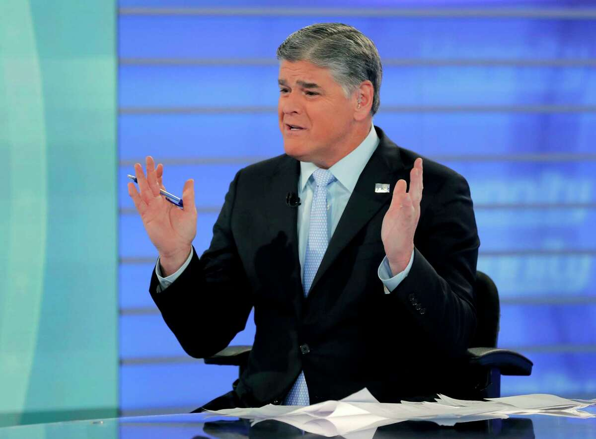 FILE - In this July 26, 2018, file photo, Fox News talk show host Sean Hannity talks during an interview during a taping of his show in New York. Bad news for President Donald Trump also means a tough time for his biggest media backer, Fox News' Hannity. His ratings are down since the election, and his rivals are up. Still, Fox will finish as the top-rated network in all of basic cable for the third straight year.