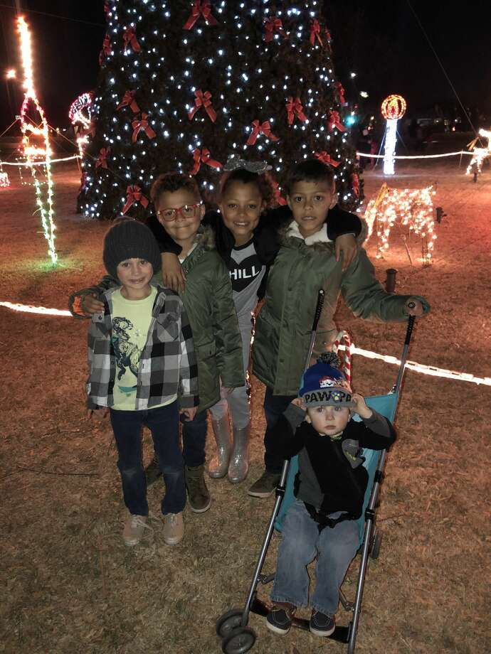 Tree lighting: Aaron Mobley, from left, Koedy Forward, Khloe Forward and Kolby Forward; and Jacob Pickett, in stroller Photo: Courtesy Photo