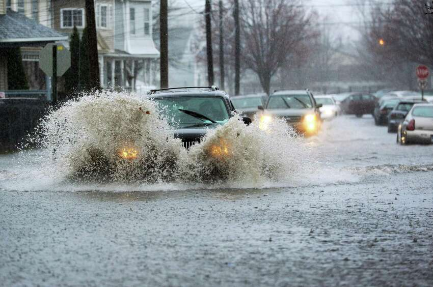 Cottage Street, Bridgeport A vehicle drives through deep water on a flooded Cottage Street in Bridgeport, Conn. on Monday, April 16, 2018. Excessive runoff from heavy rainfall caused flooding in many areas and resulted in a flash flood warning for Fairfield County.