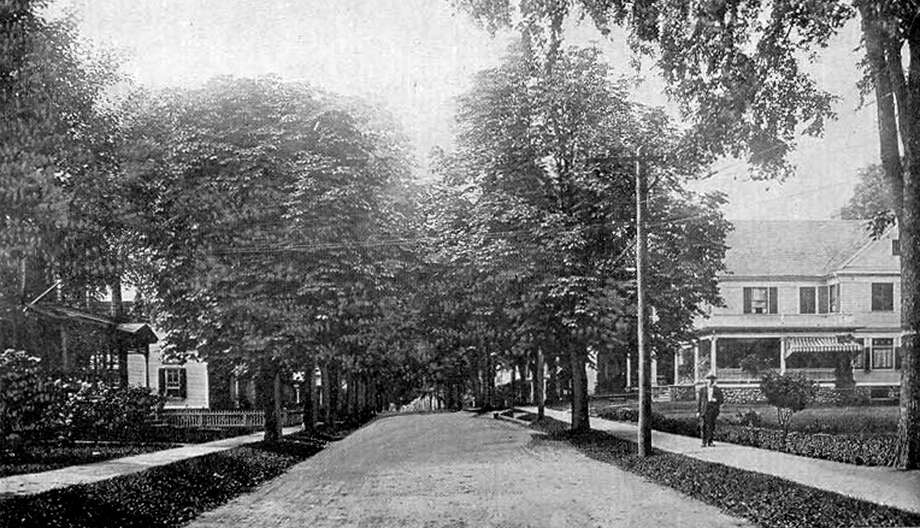 "This view of South Main Street in New Milford circa early 1900s reveals that little change has taken place over the past century in that neighborhood except, perhaps, that the road has been long since paved and not many gentlemen are seen these days walking the sidewalks decked out in what appears to be a skimmer. If you have a ""Way Back When"" photograph to share, contact Deborah Rose at drose@newstimes.com or 860-355-7324. Photo: Contributed Photo / Contributed Photo / The News-Times Contributed"