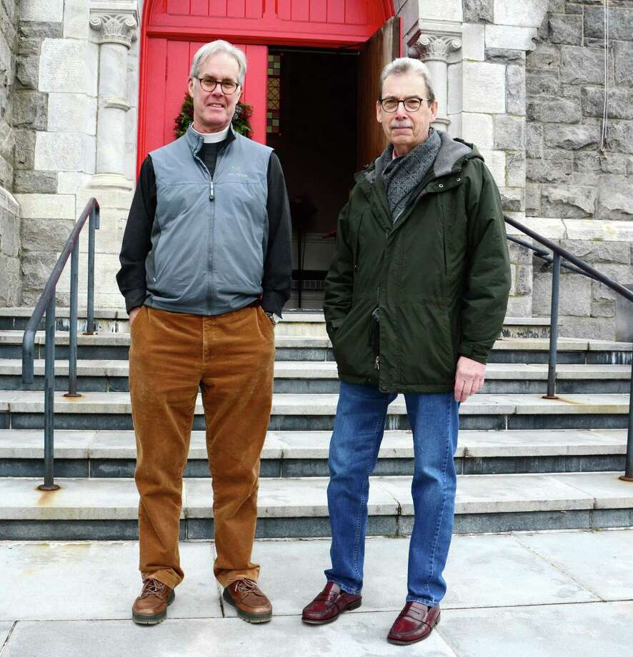 Jack Gilpin, Rector of St. John's Episcopal church in New Milford, left, and Herb St. Jean, of Danbury, at the church on Dec. 20. St. Jean led the effort to refurbish the bell that rung for the first time in years at the church on Christmas Eve. Photo: Lisa Weir / For Hearst Connecticut Media / The News-Times Freelance