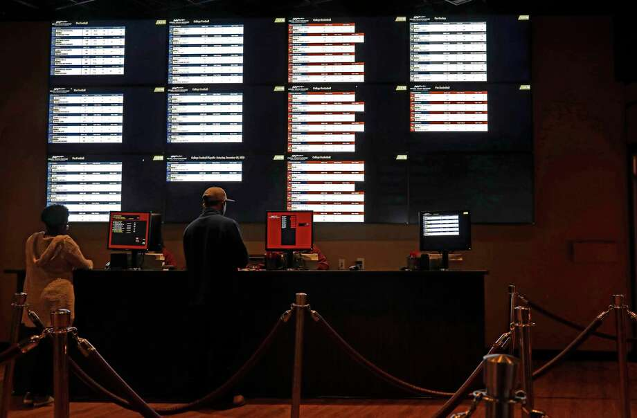In this December 2018 photo, patrons place their wages at the Pearl River Resort, in Philadelphia, Miss.Comprehensive regulations for sports gambling could be adopted in the state budget, according to incoming Senate Racing, Gaming & Wagering Committee Chair Joe Addabbo. Photo: Rogelio V. Solis, AP / Copyright 2018 The Associated Press. All rights reserved